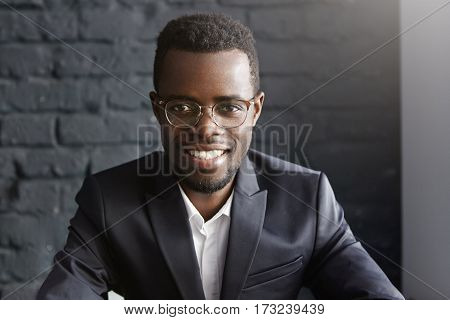 Portrait Of Confident And Successful Young African-american Businessman Wearing Stylish Glasses And
