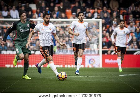 VALENCIA, SPAIN - FEBRUARY 19: (R) Montoya, (L) Iturraspe during La Liga soccer match between Valencia CF and CD Athletic Club Bilbao at Mestalla Stadium on February 19, 2017 in Valencia, Spain