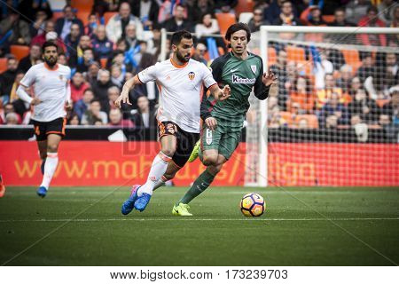 VALENCIA, SPAIN - FEBRUARY 19: (L) Montoya, (R) Iturraspe during La Liga soccer match between Valencia CF and CD Athletic Club Bilbao at Mestalla Stadium on February 19, 2017 in Valencia, Spain
