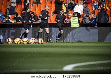 VALENCIA, SPAIN - FEBRUARY 19: Referee team during La Liga soccer match between Valencia CF and CD Athletic Club Bilbao at Mestalla Stadium on February 19, 2017 in Valencia, Spain