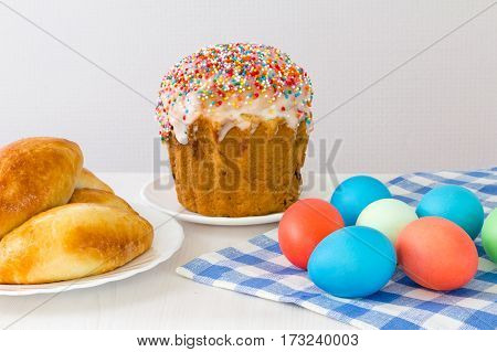 Easter eggs and Easter cake on a light background.