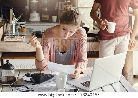 Beautiful Young Wife Planning Domestic Budget, Cutting Off Family Expenses, Trying To Save Some Mone