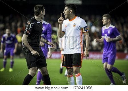 VALENCIA, SPAIN - FEBRUARY 22: (R) Perez talks with referee during La Liga soccer match between Valencia CF and Real Madrid at Mestalla Stadium on February 22, 2017 in Valencia, Spain