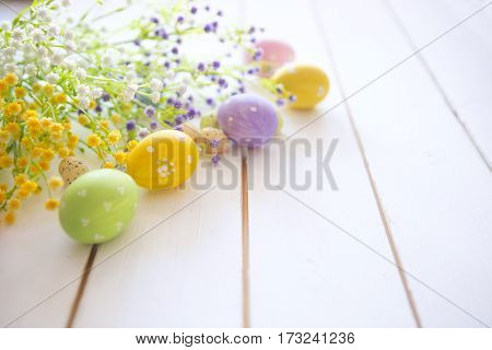 Easter Eggs With Flowers On Wooden Background