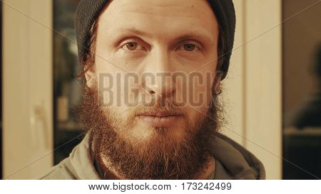 Portrait of caucasian man. He just looking in camera. Close up