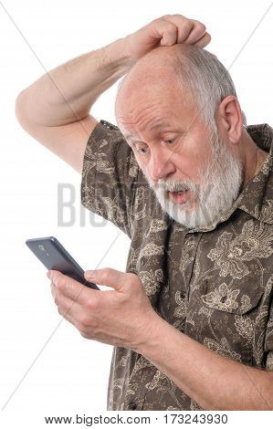Portrait of senior man surprized and confused with something at mobile smartphone, isolated on white background