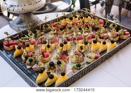 Different light snack.on tray on wedding party