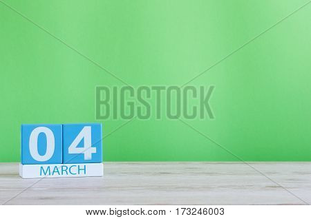 March 4th. Image of march 4 wooden color calendar on white background. Spring day, empty space for text. World Day Of the writer.