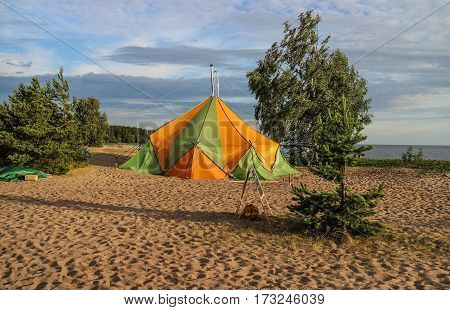 Tent camp bath on the sandy shore of the Gulf of Finland.