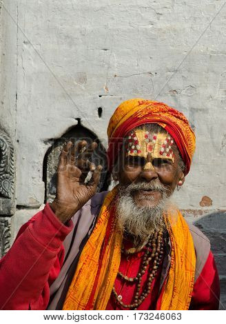Kathmandu, Nepal: unidentified Sadhu Holy man with traditional painted face, blessing in Pashupatinath Temple. February 19, 2014.