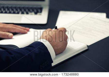 Man working at modern workplace, closeup