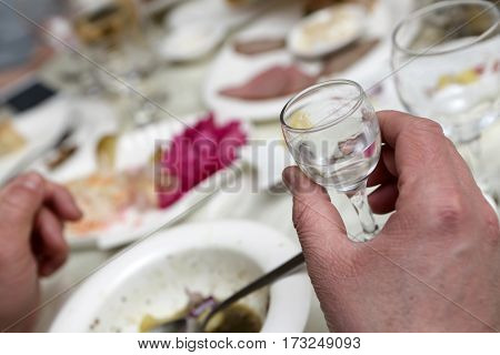 Person Holding Glass Of Vodka