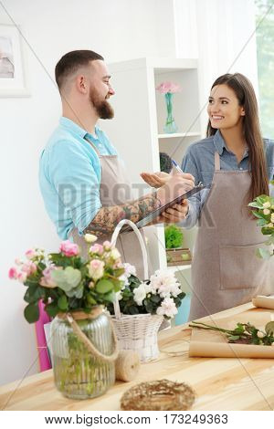 Male and female florists at workplace