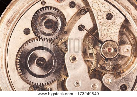 Close-up of old clock rusty mechanism with gears. Vintage toned.