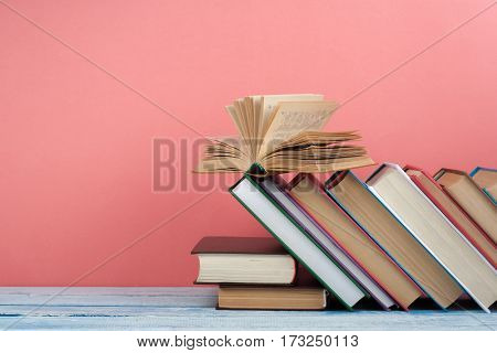 Stack of colorful books. Education background. Back to school. Book hardback colorful books on wooden table. Education business concept. Copy space for text