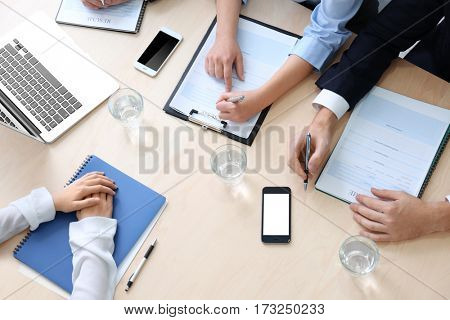 Job applicant having interview in office, top view