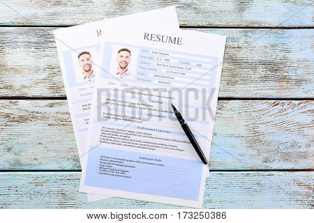 Resume forms on colour wooden table
