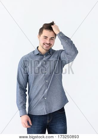 Handsome young man on light background