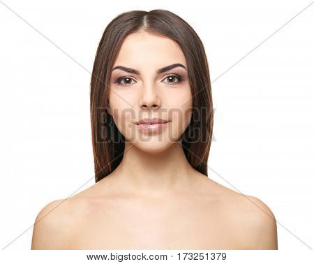 Portrait of young woman with modern makeup on white background
