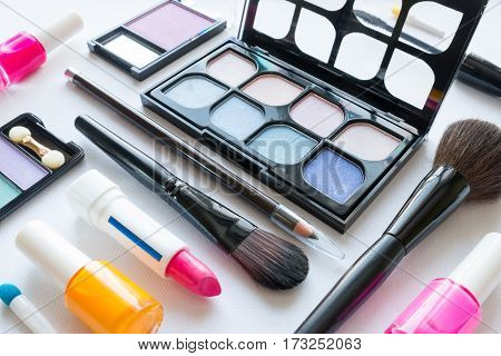 Different Cosmetics For Makeup On A White Background Closeup