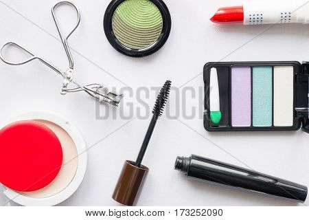 Cosmetics make up top view on white background