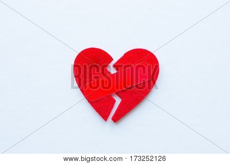 Broken Heart With A Patch On A White Background Closeup