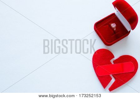 Broken Heart With A Patch And A Wedding Ring On A White Background With Space For Text