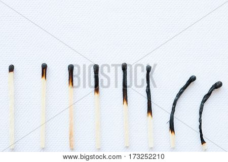 Stage Of Burning Matches On A White Background