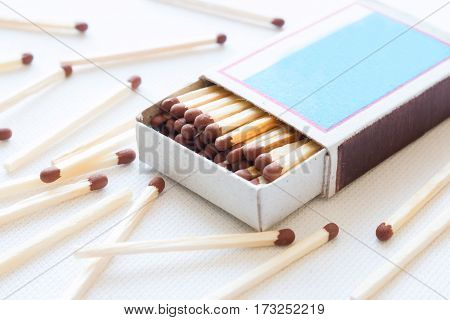 matchbox and a match on white background close up