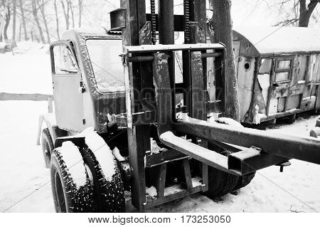Rusty Old Soviet Tractor Covered By Snow.