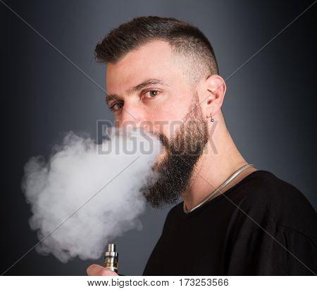 Beared Man  Smoking Electronic Cigarette