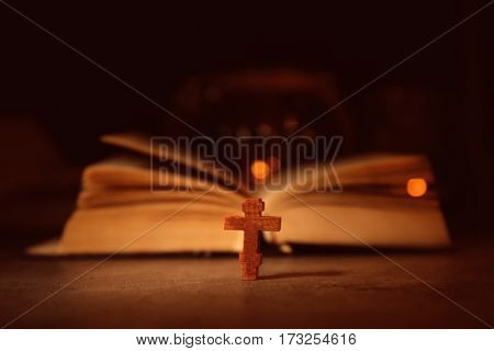 Bible with wooden cross, closeup