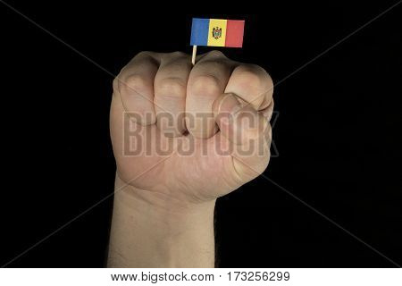 Man Hand Fist With Moldovan Flag Isolated On Black Background