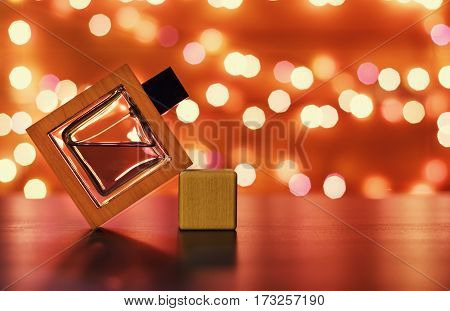 A bottle of men's Cologne on a bright background.