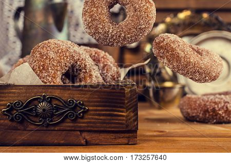Donuts with sugar and cinnamon in the fall. Selective focus.