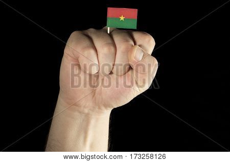 Man Hand Fist With Burkina Faso Flag Isolated On Black Background