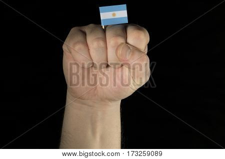 Man Hand Fist With Argentine Flag Isolated On Black Background