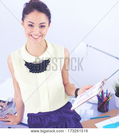 Modern young fashion designer working at studio.
