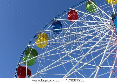 Ferris wheel Sunny day blue sky attraction entertainment fun ride circle up