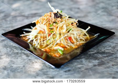 Thai Papaya Salad (Som tum Thai) on wood table