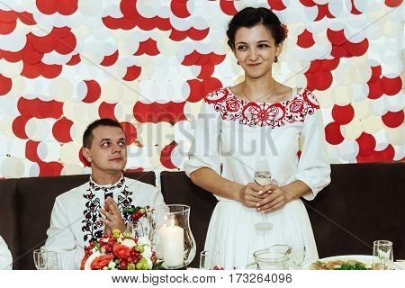Stylish Bride And Happy Groom In The Restaurant Centerpiece Reception Drinking Champagne