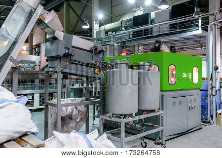 The machine for blowing plastic PET bottles. Brewery.