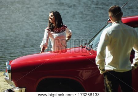 Beautiful Bride And Elegant Stylish Groom Posing Near Retro Car With Tender Feelings, Concept Of Lov