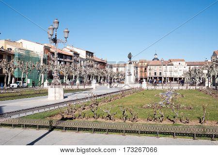 Plaza De Cervantes With The Statue Of The Writer Miguel De Cervantes