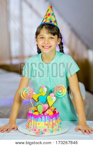 Portrait of little pretty girl with birthday cake