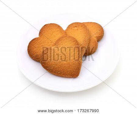 Star shaped cookies on plate on white background.