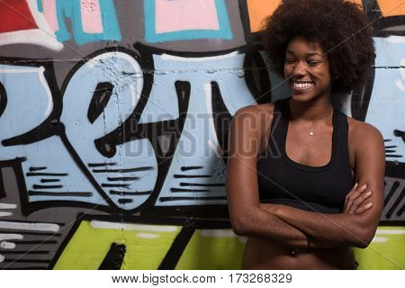 portrait of a young beautiful African American women in sports clothes after a workout at the gym