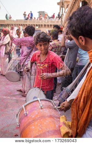 Nandgaon, India - March 17, 2016: Devotees celebrate Lathmar Holi in Nandgaon village, Uttar Pradesh, India.