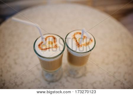 Two Cups Of Cappuccino Coffee With Heart Shaped.