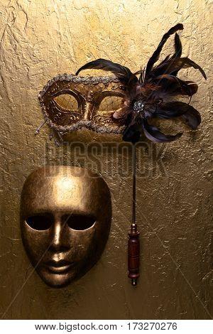 Carnival Masks On A Golden Background